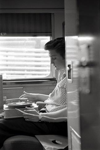 Elvis Listens to a Quick Cut by Alfred Wertheimer