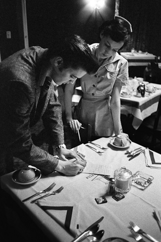 Elvis Signs the Billfor Lunch by Alfred Wertheimer