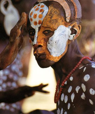 Painted Karo courtship dancer by Carol Beckwith and Angela Fisher