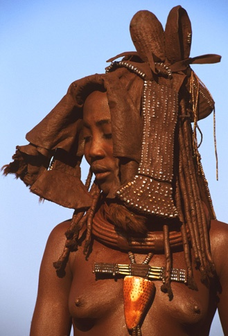 Himba woman with Ekori headdress by Carol Beckwith and Angela Fisher