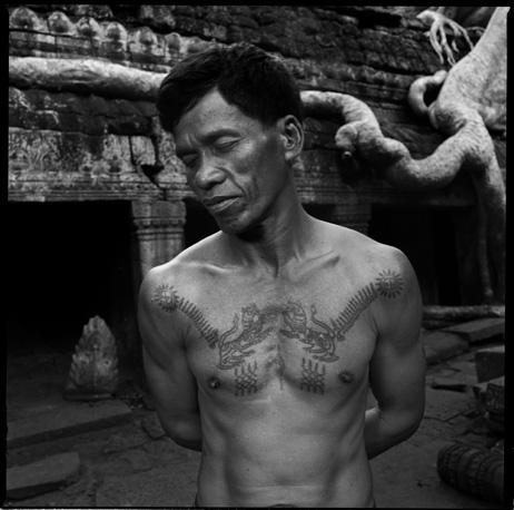 Man with traditional Khmer tattoos by Chris Rainier