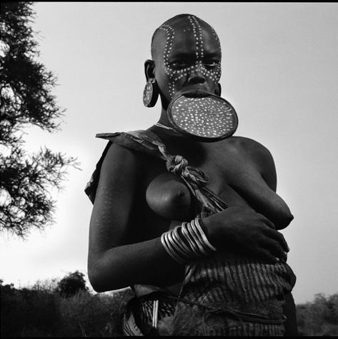 Mursi Tribal woman with traditional lip plate by Chris Rainier