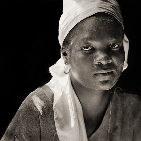 Woman in Flour Mill, Haiti, 1984 by Dana Gluckstein