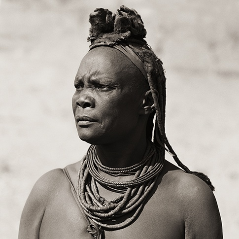 Himba Woman with Cowhide Headdress, Kaokoland, Namibia, 2007 by Dana Gluckstein