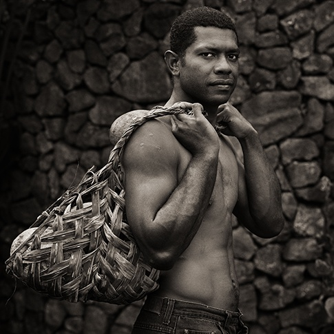 Estate Laborer Carrying Coconuts, Fiji, 2008 by Dana Gluckstein