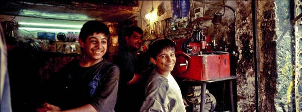 Auto shop boys, Baghdad by James Longley