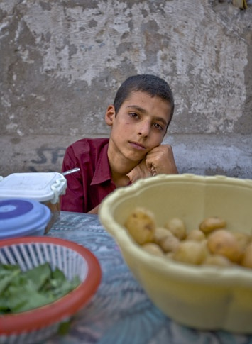 Boy selling vegetables, Qom by James Longley
