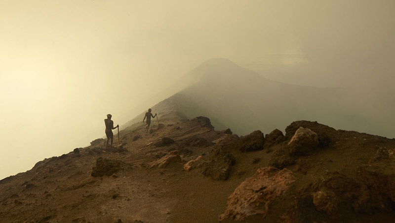 Kastom Men Escape Sulphur Cloud of Mount Yasur by Joey L.