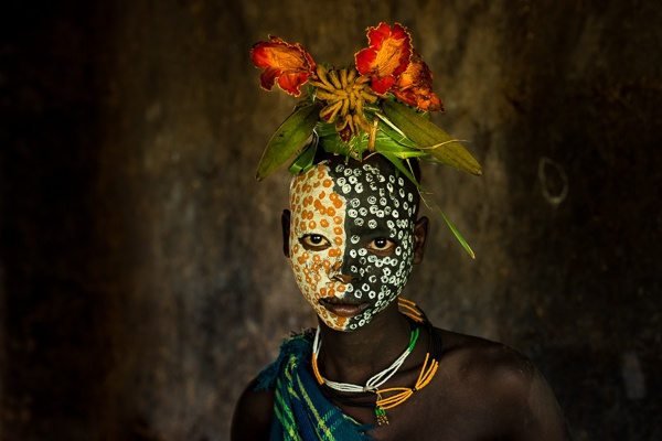 Portrait of a Suri Girl Adorned with Flowers by John Rowe