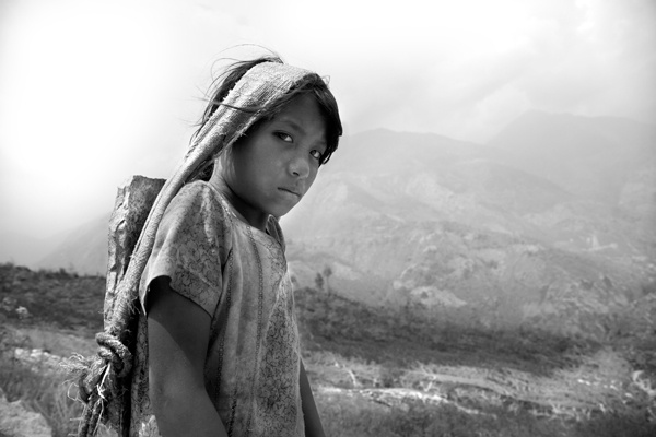 Girl with Stone on Back-Nepal by Lisa Kristine