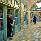 Shopkeeper sweeping, Tabriz