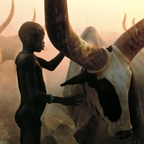 Dinka Child and His Animal, South Sudan