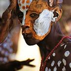 Painted Karo courtship dancer
