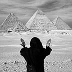 Bedouin Woman Pays Tribute to Pyramids