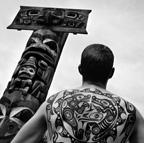 Man with Haida tattoos, totem poles