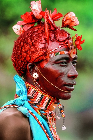 Samburu Warrior with Silk Rose Adornments, Kenya by Carol Beckwith and Angela Fisher
