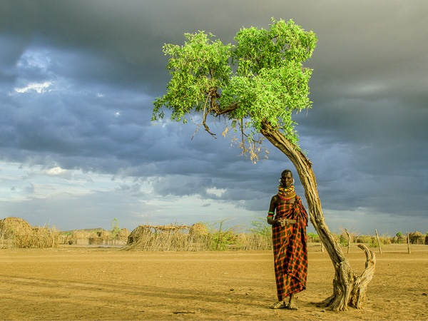 Turkana Woman by Tree, Kenya by Carol Beckwith and Angela Fisher