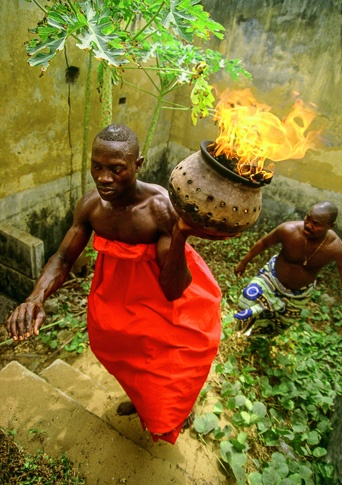 Voodoo Priest with Flaming Urn, Ouidah, Benin by Carol Beckwith and Angela Fisher