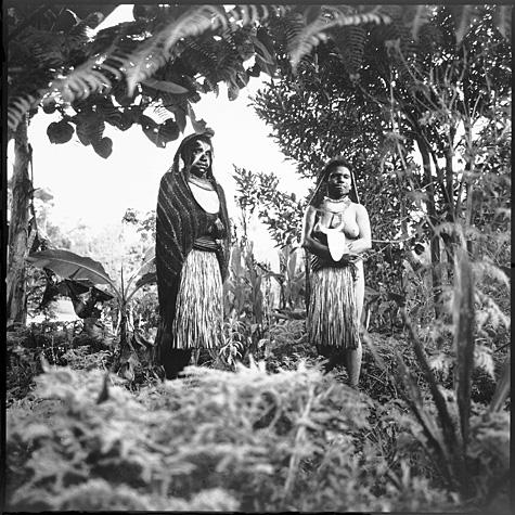 Two women wearing marriage ritual costumes by Chris Rainier