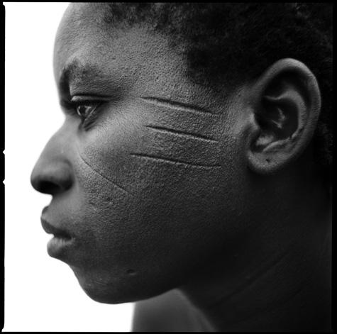 Woman with tribal scarification by Chris Rainier