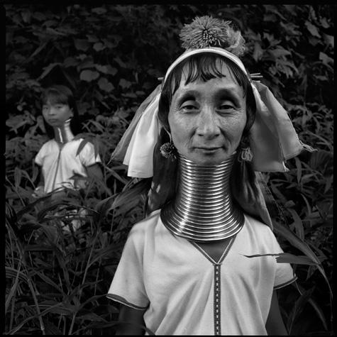 Long-necked woman and child, Karen Paduang tribe by Chris Rainier