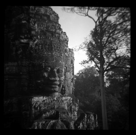 The enigmatic faces of Banyan Temple by Chris Rainier