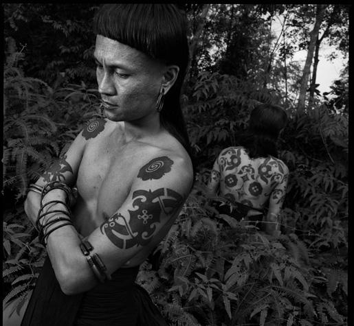 Dayak man with tattoos by Chris Rainier