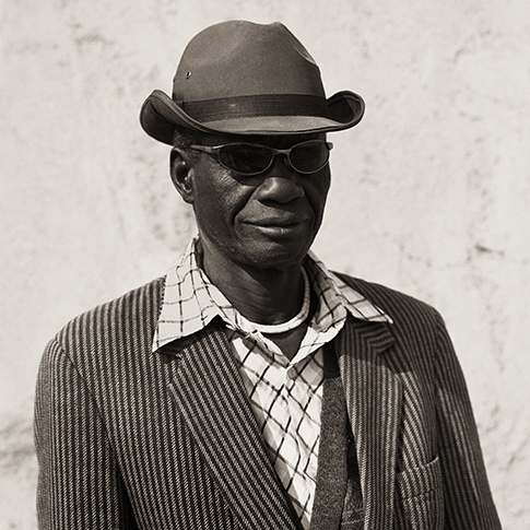 Herero Husband with Striped Jacket, Kaokoland, Namibia, 2007 Triptych III by Dana Gluckstein