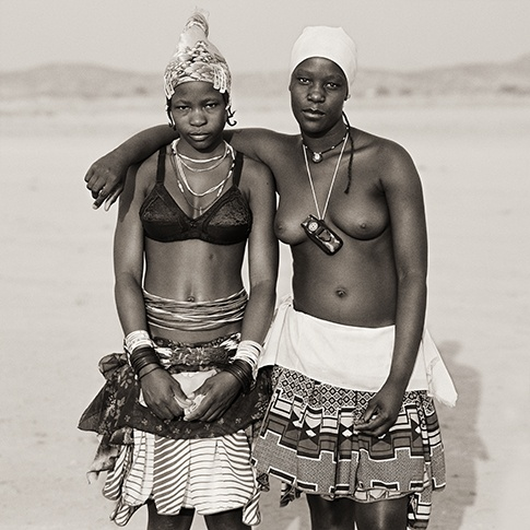 Ovazemba Girls with Toy Cell Phone, Opuwo, Namibia, 2007 by Dana Gluckstein