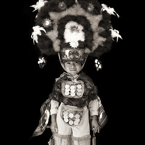 Boy with Plumed Headdress, Oaxaca, Mexico, 2004 by Dana Gluckstein