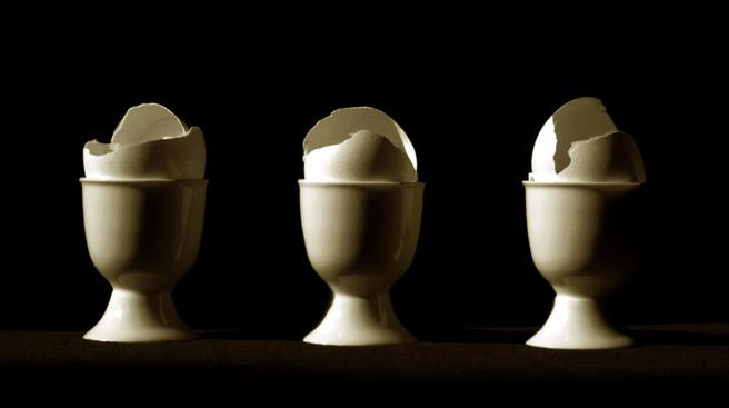 3 egg shells in 3 cups by T.J. Dixon and James Nelson