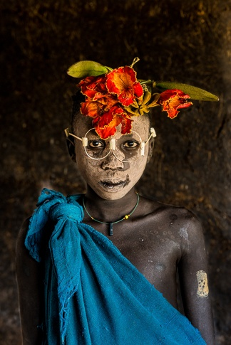 "Portrait of a Suri Boy Adorned with Flowers and ""Glasses"" by John Rowe"