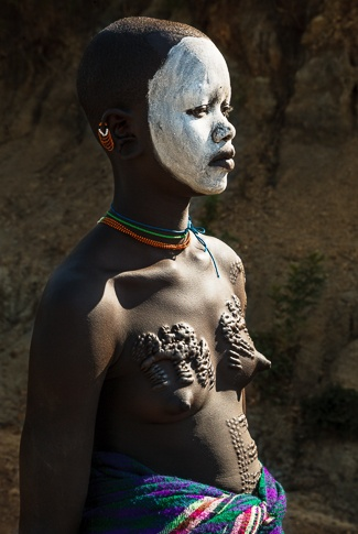Portrait of a Suri Girl with Traditional Scarification by John Rowe