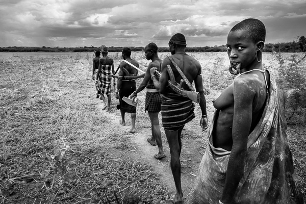 On the Move, Mursi Tribe by John Rowe