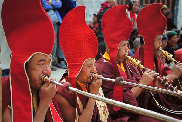 Four Lamas Blowing Horns, Tiji Festival, Lo Montang by Kenneth Parker