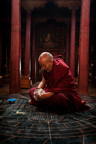 A High Lama Performing Introduction Prayers Before Starting a Sand Mandala, Thupchen Temple by Luigi Fieni