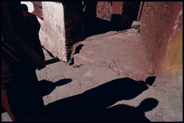 Monks Shadows at Ganden Monastery by Marissa Roth