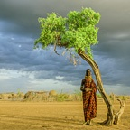 Turkana Woman by Tree, Kenya