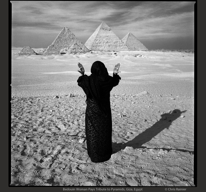 Bedoin Woman Praying to the Pyramids, Giza by Chris rainier